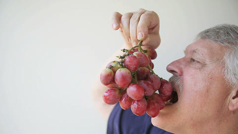 Man Eats Large Grapes stock footage