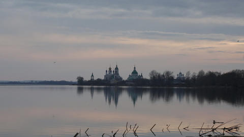 Seagulls fly over Nero's lake against Spaso-Yakovlevsky Monastery in Rostov Footage