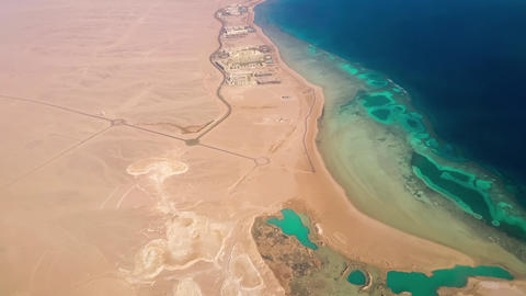 Aerial View From The Aircraft To Desert And Sea, Sunny Day stock footage