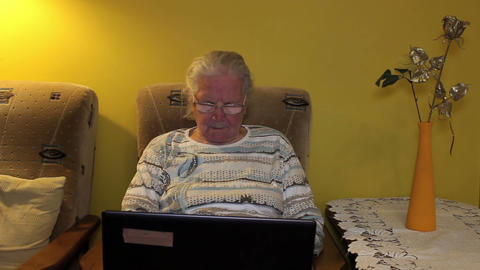 Elderly Woman Using Laptop Computer stock footage