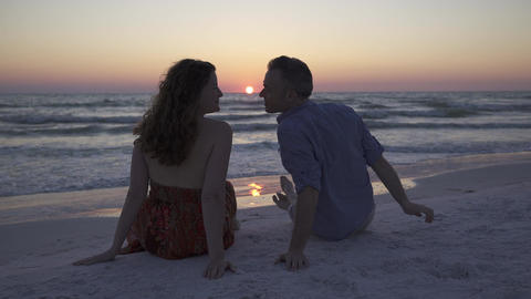 Couple Relaxing On Beach At Sunset (4 Of 5) stock footage