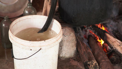 Cooking Moonshine stock footage
