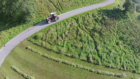 Tractor Aerial View. Tractor On A Pass In The Alps Of Austria stock footage