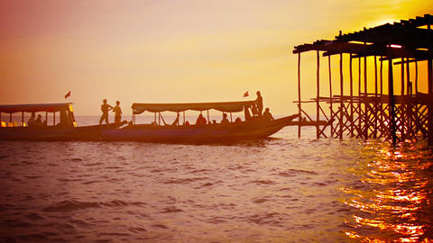 Foreign Tourists Visit Local Harbor At Sunset In Cambodia stock footage