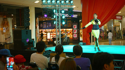 PHUKET. THAILAND - CIRCA FEB 2015: Singer performing on a stage with professiona Footage