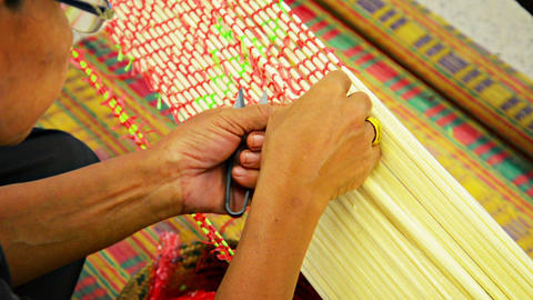 BANG PA-IN. THAILAND - CIRCA NOV 2013: Local Artisan Working With Colored Thread stock footage