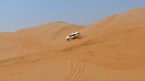 4WD Car Driving Over Dunes In Oman Desert stock footage