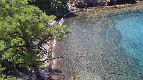 Sandy white beaches of Marmaris, turquoise clear sea, pine trees on every corner Footage