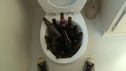 Beer Bottle Toilet Flush stock footage