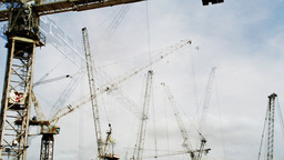 crane munching urban industrial construction building Footage