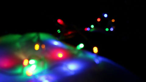 Racking Soft Focus Shot Of Colorful Outdoor Christmas Lights stock footage