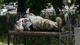 Man Sleeping On A Bench stock footage