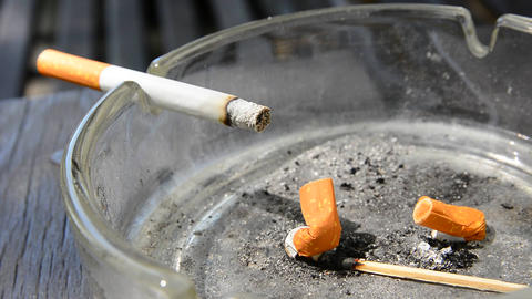 Cigarette In The Ashtray stock footage