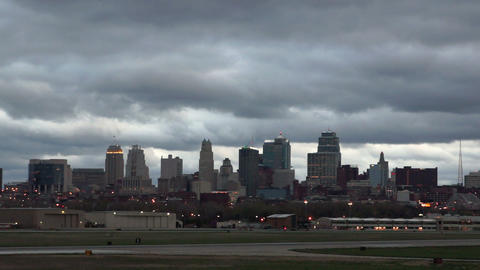 Kansas City Downtown City Skyline Storm Overhead Airport Runway stock footage