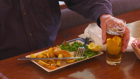 Male Drinks Beer At Lunch stock footage