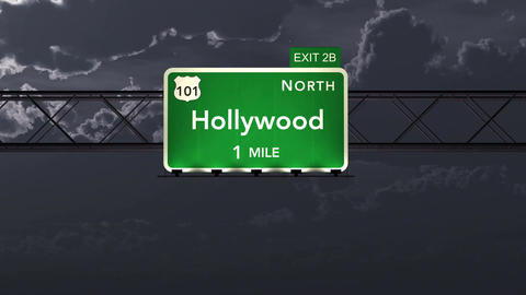 4K Passing Hollywood USA Interstate Highway Road Sign at Night with Matte 1 neut Animation