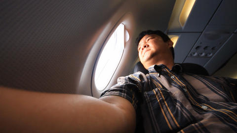 young man on airplane looking outside Footage
