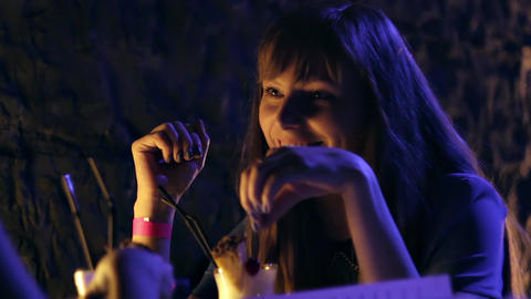 1080p Attractive Young Woman Smiling Sitting At Table In Nightclub stock footage