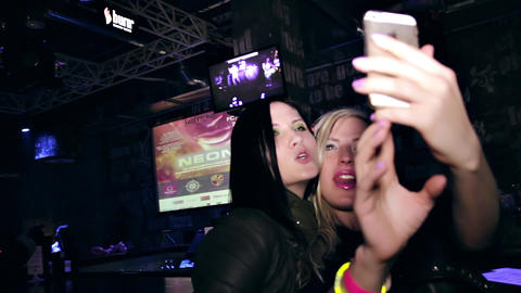1080p Two Young Women Making Selfie With Cell Phone On Club Party stock footage