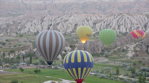 Multi-colored Balloons Fly Over Rocks stock footage