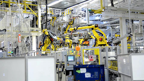 Working Yellow Robotic Arms In The Factory stock footage