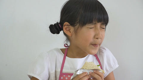 Slow Motion Of Little Asian Child Eating Delicious Sandwich stock footage