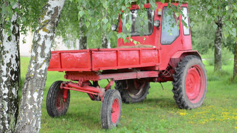 Retro Red Tractor Stand Near Birch Trees And Branch Move In Wind stock footage