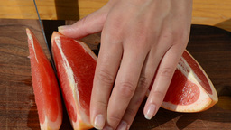 Hand Slice Fresh Ripe Juicy Grapefruit Pomelo Fruit Into Pieces stock footage