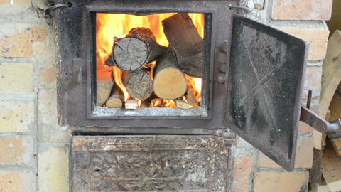 firewood wood burn in retro old rusty rural kitchen stove Footage