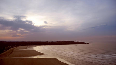 Time-lapse Scenery Of A Bay In Evening During The Tide - Waves And Clouds stock footage