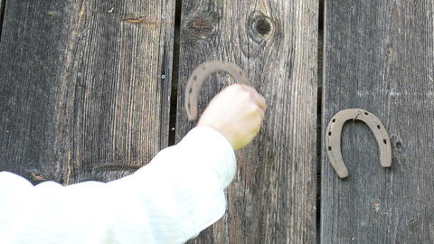 Retro Rusty Horse Shoe Hand Hanging Old Wooden Rural House Wall stock footage