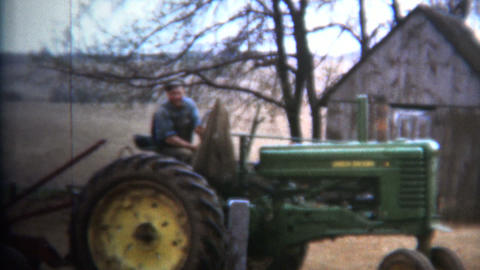 (8mm Vintage) 1952 Proud Iowa Farmer On Tractor stock footage