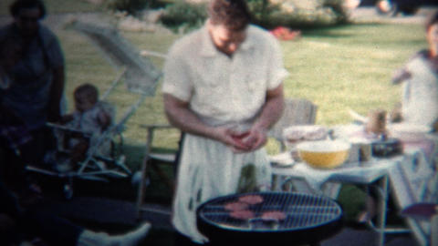 (8mm Vintage) 1954 Dad Making Hamburgers For Lunch. Iowa, USA stock footage