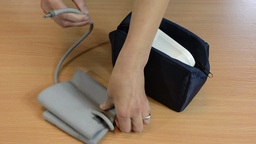 Nurse Hands Put Pressure Check Tool To Bag stock footage