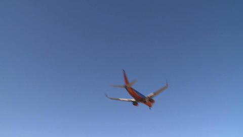Airplane flies by lens (3 of 4) Footage