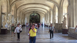 Visitors Take Pictures Inside The Louvre Museum In Paris stock footage