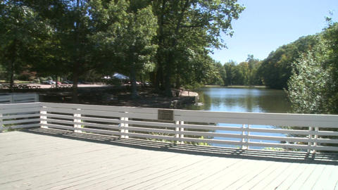 Deck Overlooking Water On Grounds Of Nature Center stock footage