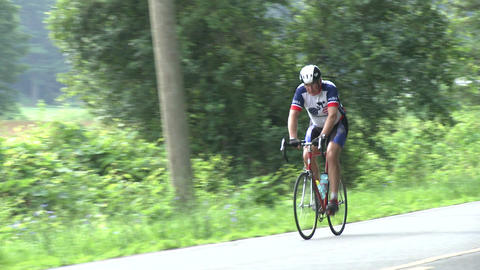 A Cyclist Riding His Bike In The Rural Countryside stock footage