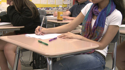 Junior High Girl Sitting In Classroom stock footage