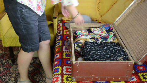 Woman Unpack Her Clothes From Old Travelling Port Trunk Bag stock footage