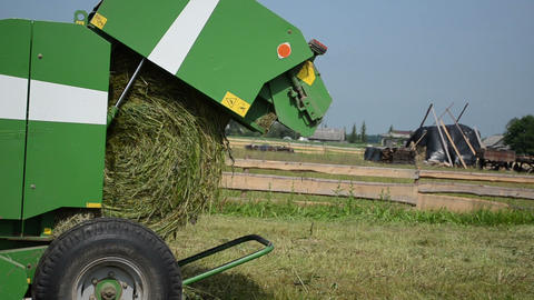 Cut Grass Equipment Turns The Cut Green Grass In Large Bales stock footage