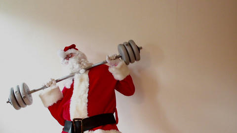 Santa Claus trying lift heavy weights and collapsing Footage