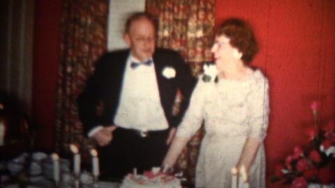 1958 - Old Couple Wedding Anniversary Cake stock footage