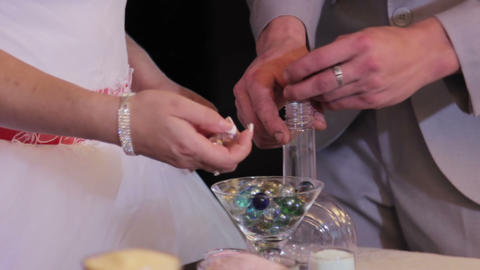 Sand Ceremony Being Performed At Wedding. Hands Of Bride Holding Vase With Color stock footage