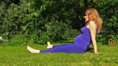 Pregnant Woman Yoga Exercise During Pregnancy Outdoor At Garden stock footage