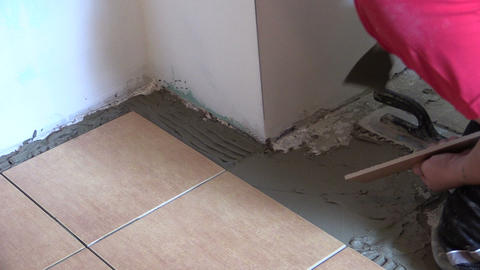 professional work at home interior floor tiling Footage