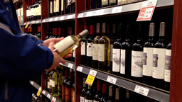 A Hand Takes Bottles Of Wine From The Shelf stock footage