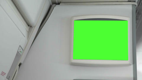 Monitor With A Green Screen Inside The Aircraft stock footage