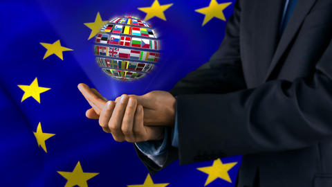 Ball Made Of European Nationals Flags Turning On Hands In Front Of European Flag stock footage