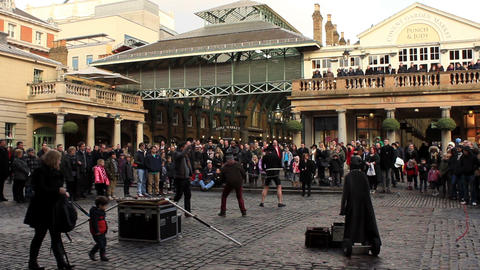 Covent Garden In London - People Watching Entertainer And Some Getting Involved stock footage